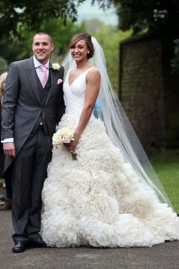 http://www.vogue.co.uk/news/2013/05/20/jessica-ennis-wedding-dress---marries-andy-hill-in-derbyshire