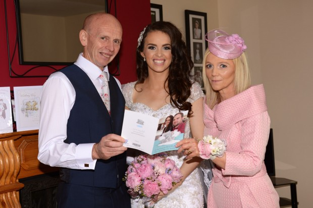 Cathy is all smiles beside her parents Bernie and Sean McMenamin on her wedding day.
