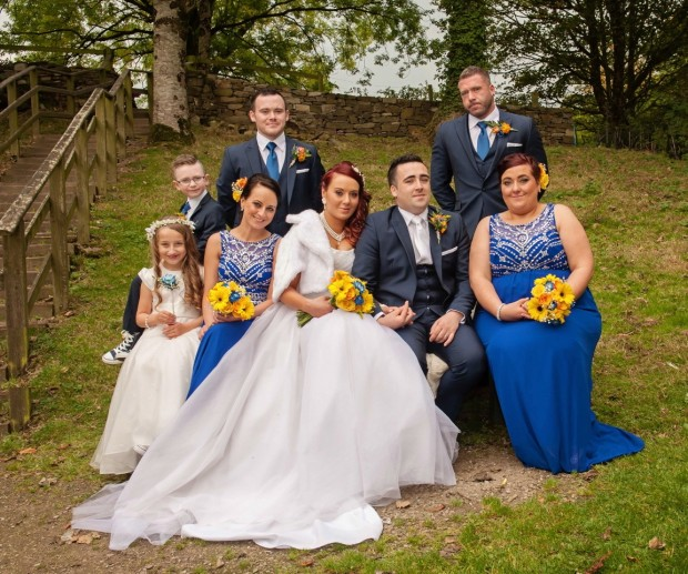 The new Mr and Mrs McGinn alongside maid of honour Tanya McIlroy, and best man Justin McGinn. Also pictured are bridesmaid Karolina Dlogosz, groomsman Conal McGinn, flower girl Julia McGinn and page boy Jack McGinn. Pictures: Mary McGinn