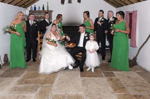 The newlyweds share a drink for luck and a giggle on their December wedding day. Also pictured is maid of honour, Janine Potts, bridesmaids Emma Hannigan, Lisa Patton and Jade Arbuckle and flower girl Kyla Friel. They are joined by best man Davy Devlin and groomsmen, Kieran Devenney, Bob McNulty and Jimmy Tinney. Pictures DTR Photography.
