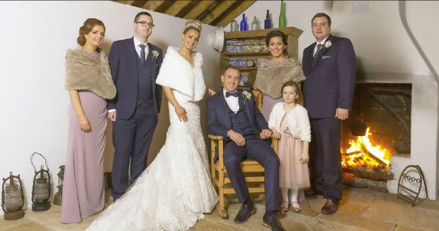 The newlyweds, Louise and Andrew Devine, alongside maid of honour Ashley O'Neill, bridesmaid Ciara Devine and flower girl Niamh Devine. Also pictured is best man Dominic Devine, and groomsman Michael Devine.