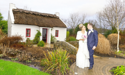 Newlyweds Louise and Andrew share a kiss outside wedding venue Villa Rose Hotel, Ballybofey on the afternoon of their New Year's Eve wedding.