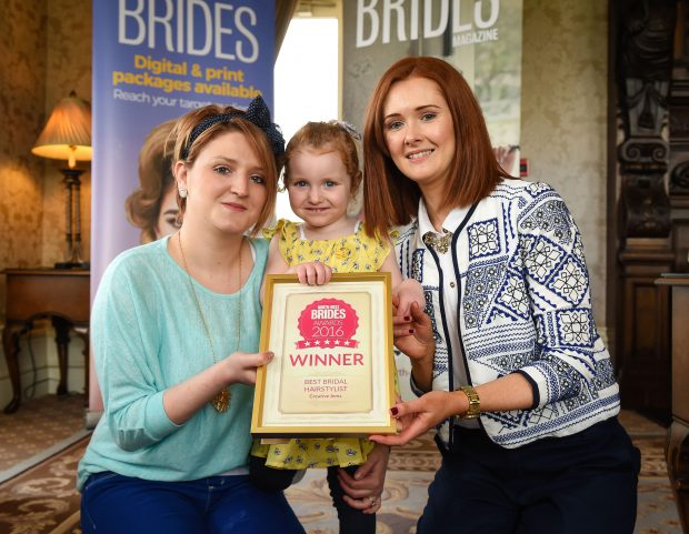 Jemma Donnell, Creative Jemz is pictured receiving the Best Bridal Hairstylist award from Maired Kelly, North-West brides. Helping Jemma receive the Award is Jemma's daughter Rose.