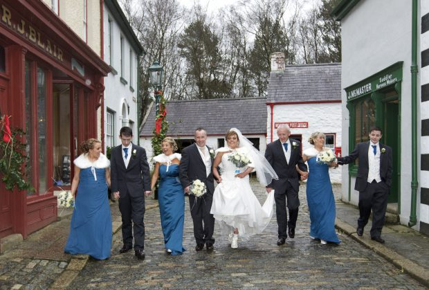 The bridal party are all smiles as the new Mr and Mrs McLaughlin celebrate.