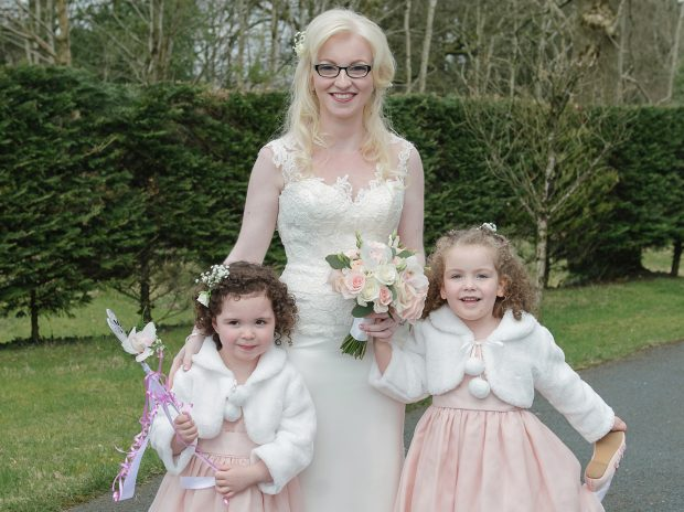 The new Mrs McCarney with her flowergirls Ellie Owens and Cara Pritchard.