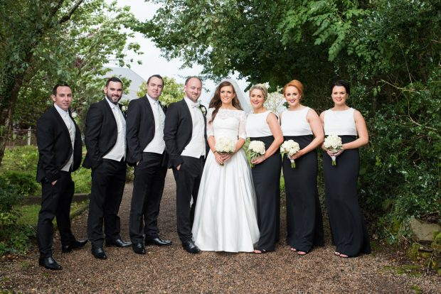 Newlyweds Alice and Tiernan McAleer, alongside maid of honour, Stella McCrossan and bridesmaids, Jelena Donnelly and Joanne McAleer. Also pictured is best man, Aaron McAleer and groomsmen Ronan Quinn and Shane McLaughlin.