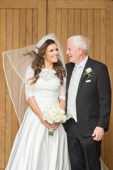 The blushing bride, Alice McDonnell and her father, Charlie McDonnell are all smiles as they celebrate the day of the Trillick woman's wedding.