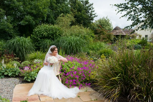 Clodagh is all smiles as she enjoys the pretty private gardens of the Villa Rose Hotel, Ballybofey on her summer wedding day