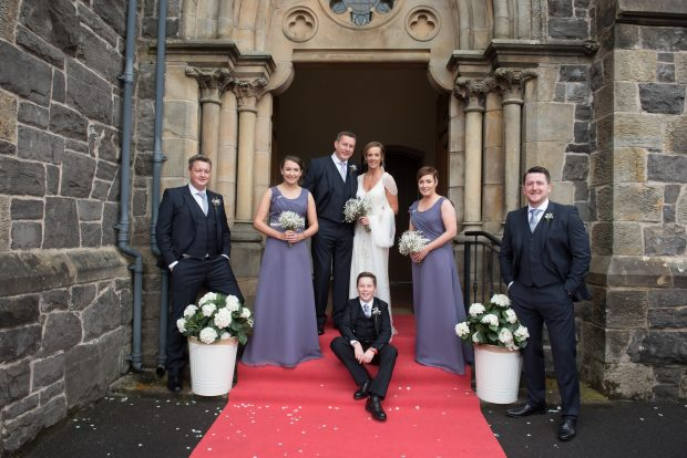 Gillian and Richard Holcroft with their bridal party outside St Columba's Church in Omagh.
