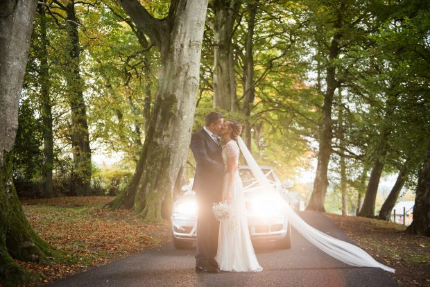 Gillian and Richard share an intimate moment on their autumn wedding day.