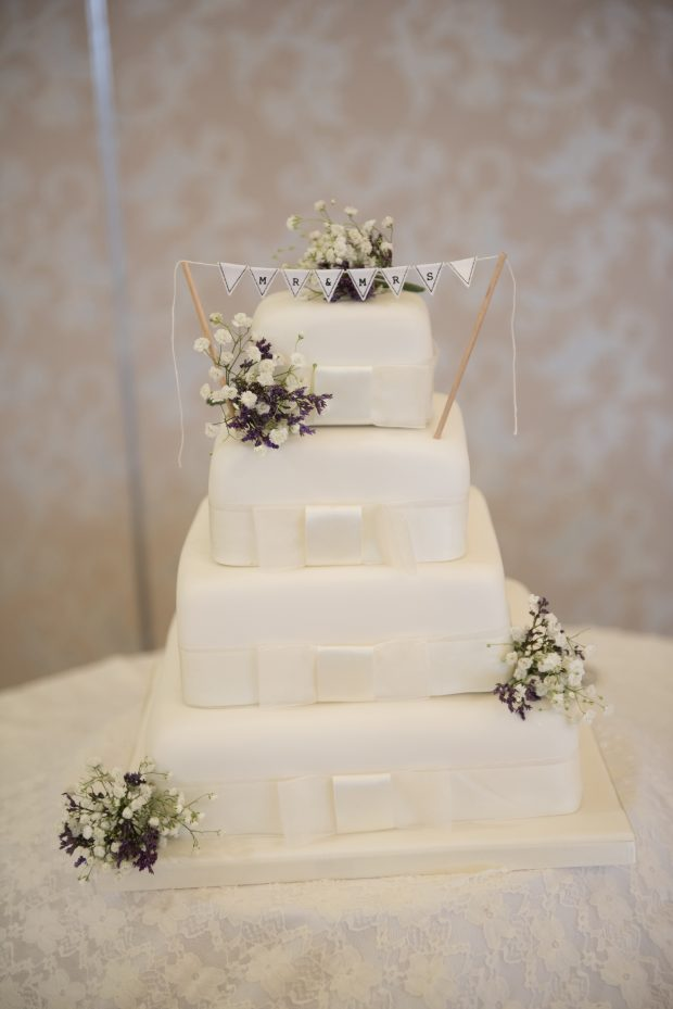 Richard and Gillian's beautifully decorated four-tier wedding cake.