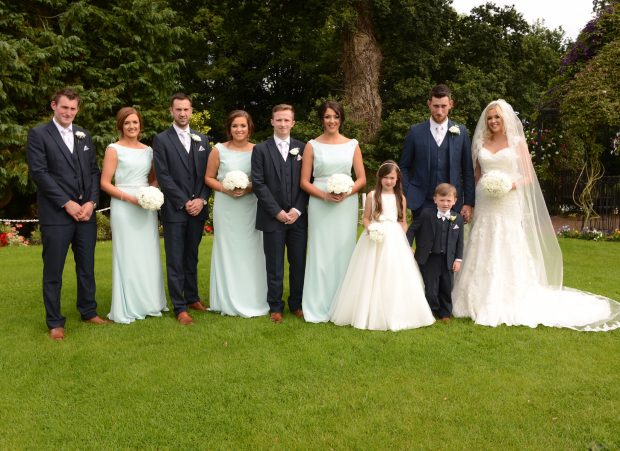 Newlyweds, Zara and Ian alongside their maid of honour, Trudy Crozier and best man, Michael Reid. Also pictured are bridesmaids, Kate Crozier and Joanne Milligan, flower girl Chloe Crozier, groomsmen, Neil Copley and Steven Thompson and page boy, Carl Crozier.