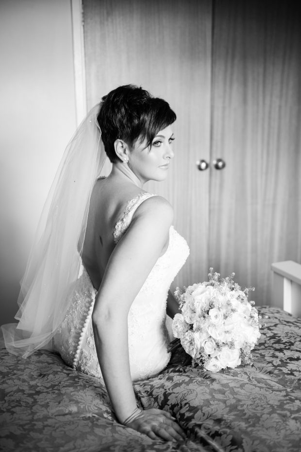 Helen Kelly shows off her beautifully elegant ivory wedding gown, featuring sparkles and feminine lace.