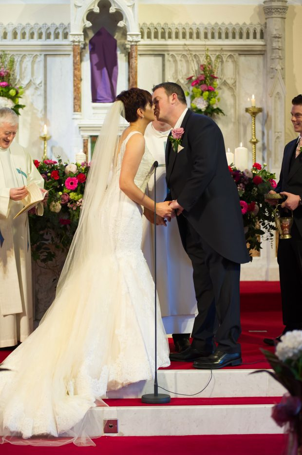 Helen and Junior share a kiss after being pronounced husband and wife.