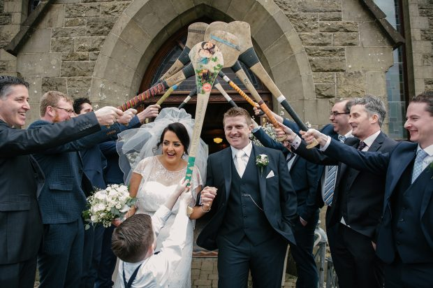 Una and Paul leave the church through a guard of honour formed by hurlers.