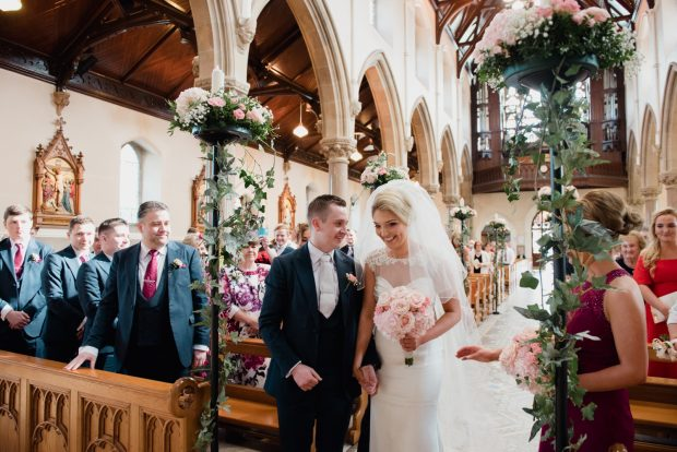 Martin and Chantelle are all smiles during their elegant wedding ceremony, held in the Sacred Heart Church, Omagh. The newlyweds were married by Monsignor Donnelly and Father Kearney.